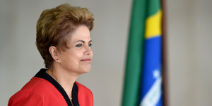 Brazil's President Dilma Rousseff gestures during the welcome ceremony of the the MERCOSUR Summit of Heads of State and Associated States at Itamaraty Palace in Brasilia, Brazil, on July 17, 2015. AFP PHOTO/EVARISTO SA        (Photo credit should read EVARISTO SA/AFP/Getty Images)