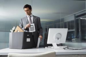 Businessman packing office belongings --- Image by © Nic Ortega/Corbis